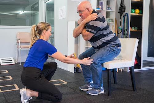 physio helping patient in the gap