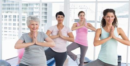 women exercising doing balance falls prevention exercise